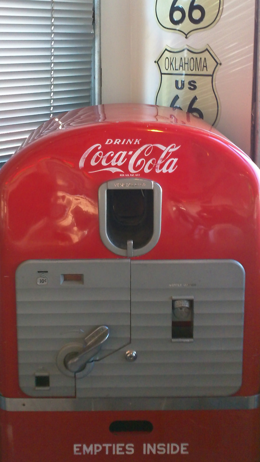 Old Vendorlator Coke machine at 66 Diner (cropped) -- ISO 100, f2.8, 1/30 sec.