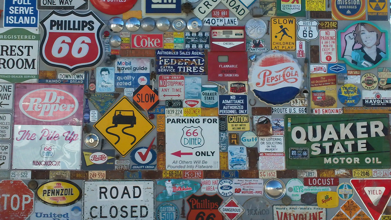 Wall o' signs (cropped) -- ISO 50, f2.8, 1/640 sec.