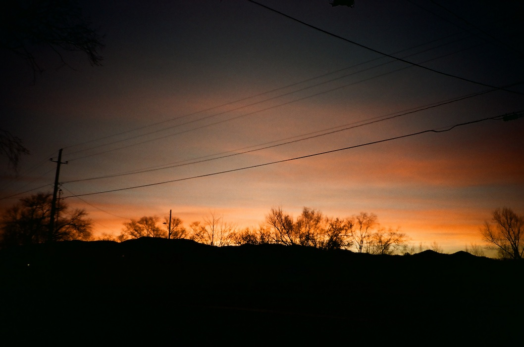 Power line sunset -- fierce vignetting but it works