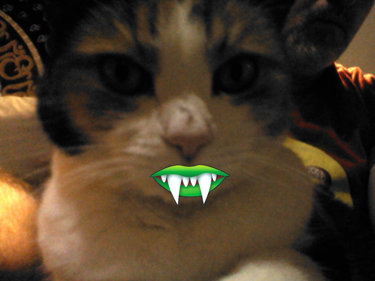 Zoe with vampire teeth -- too close and too dark but she looks more ee-ville that way