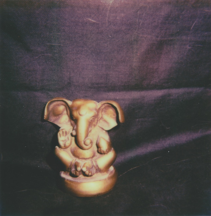 Ganesha with a changing bag background.