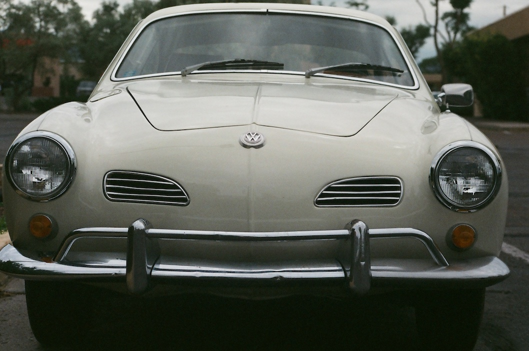 Sigma 50mm at f/8.  The Ghia I had was a Flintstone-mobile -- you could see the road through the rusted floorboards.