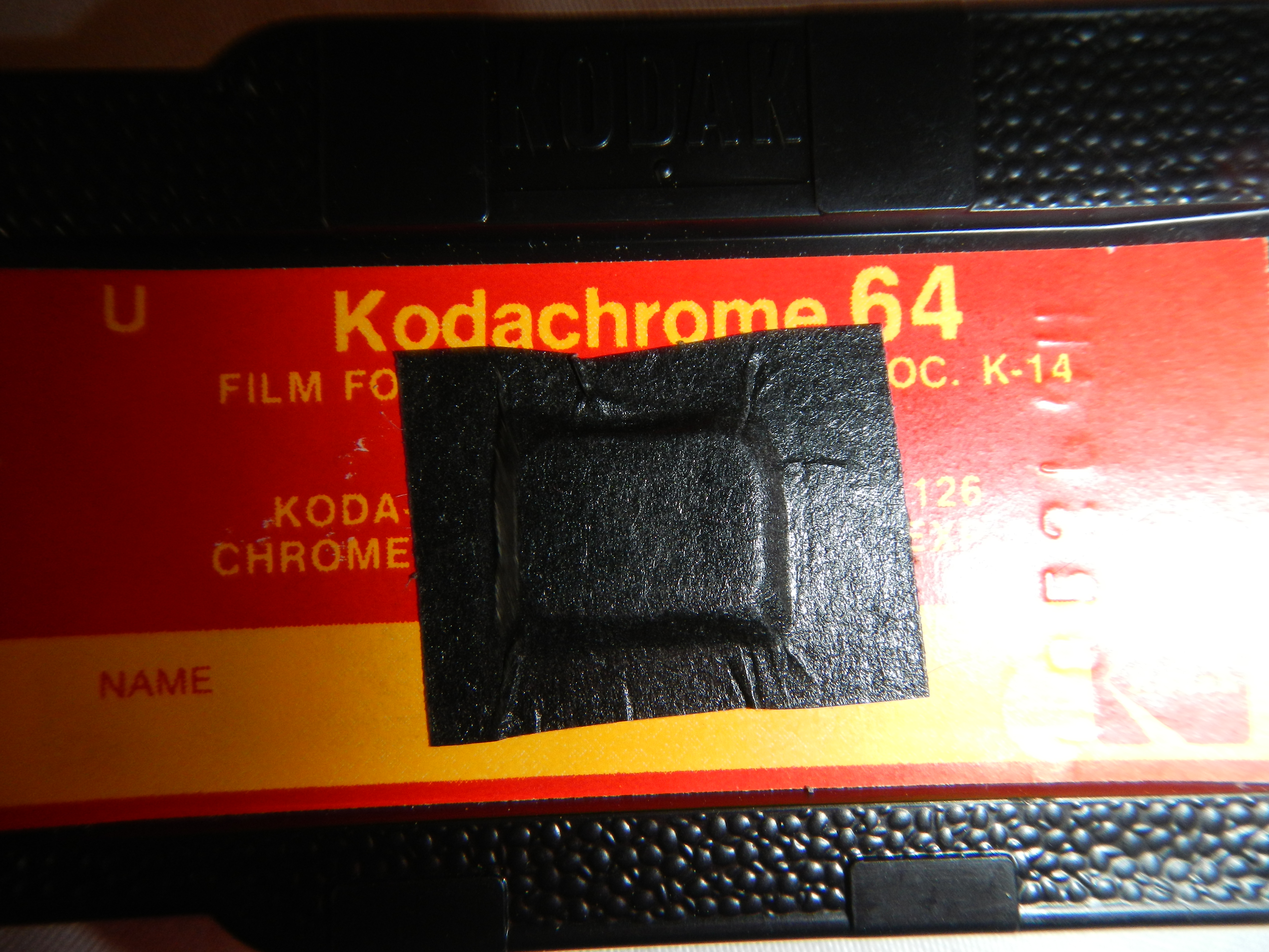 Tape the film count window on the cartridge and the camera.