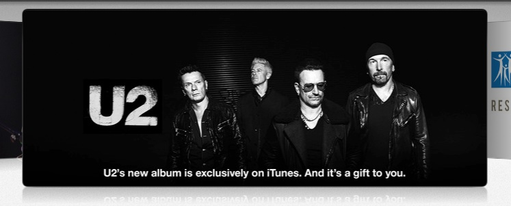 When I log out of the iTunes account, the album rotator display just happens to go past the new U2 album.