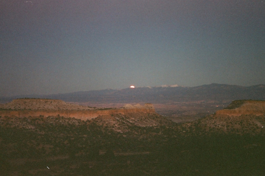 Full moon rising over the Sangre De Cristos.  Program AE.