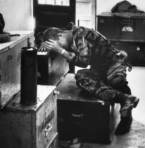 In a supply shack, hands covering his face, an exhausted, worn James Farley gives way to grief.  LARRY BURROWS, Near Da Nang, Vietnam, 1965 -- Larry Burrows—Time & Life Pictures/Getty Images