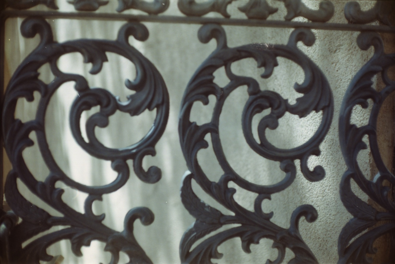 Iron gate detail.  I missed the focus point a little at f/1.8 and got the stucco sharp.