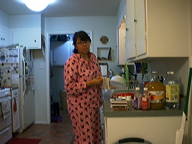 My sweetie in her cat PJs.  I don't think she believed it would work.