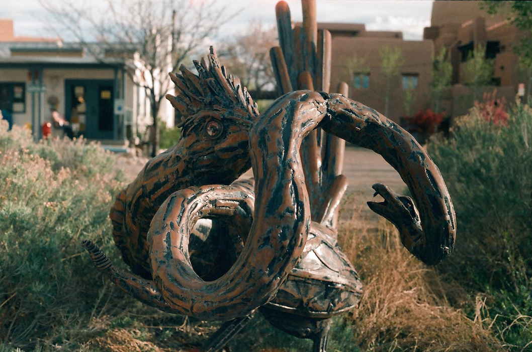 Roadrunner and snake sculpture.