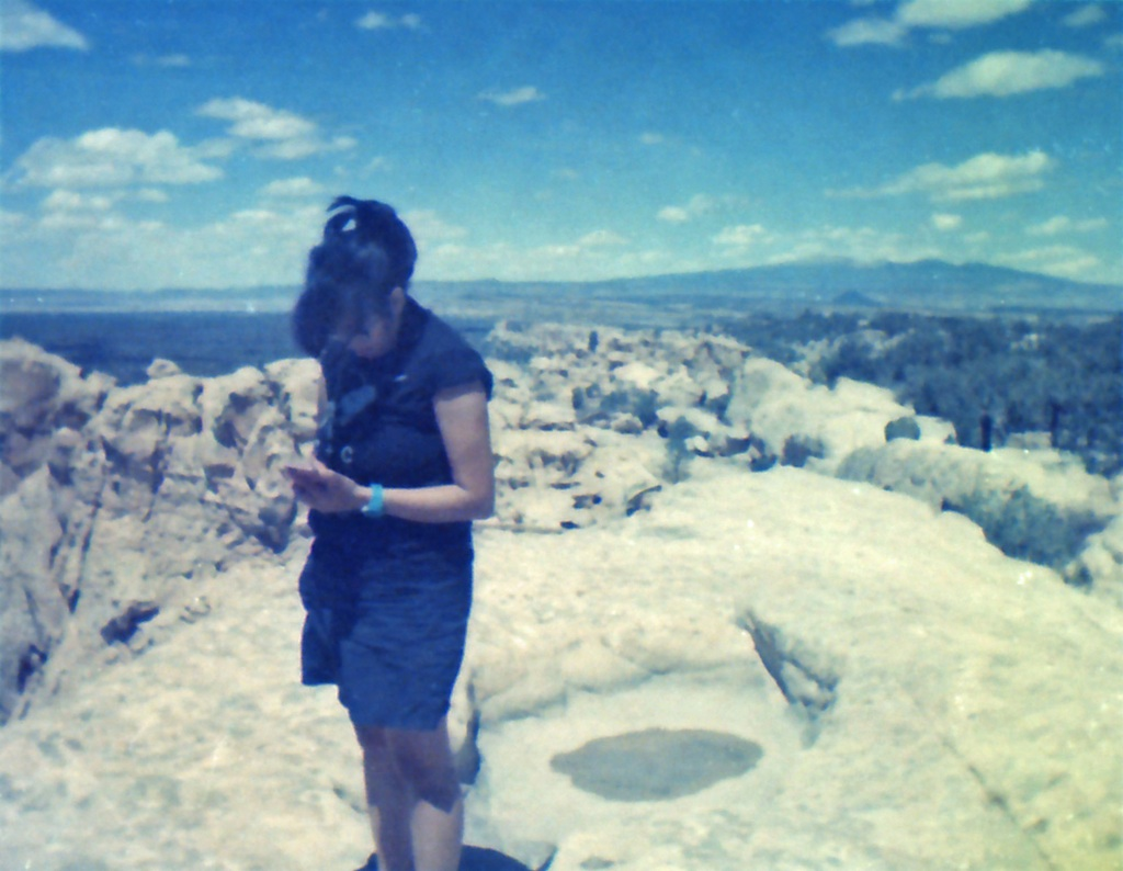 Not checking texts, she was taking photos of the evaporating pools.
