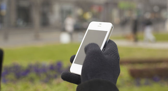 """Smartphone in hand with gloves"" by Adam Radosavljevic - GettyImages/iStockphoto"