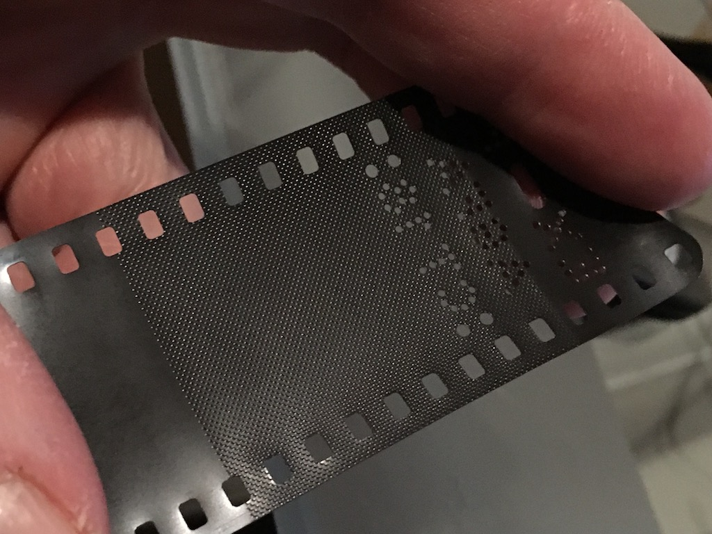 The leader and tail are textured to stiffen them.  It probably helps the film not slip into the cartridge too.