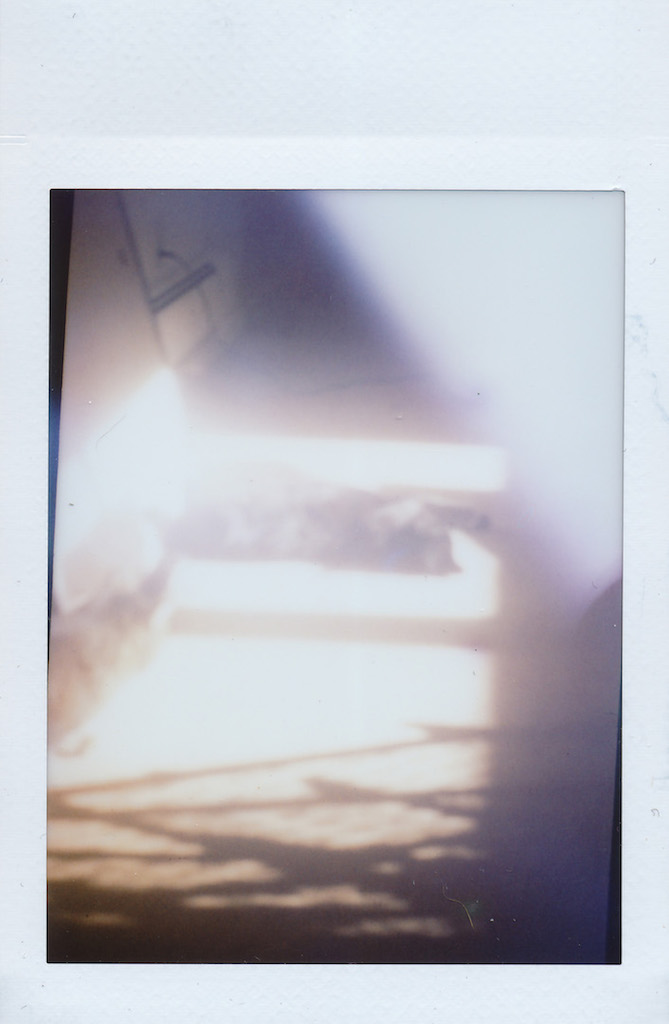 Trinity in the sun.  Instax with the tape/cardboard seals.