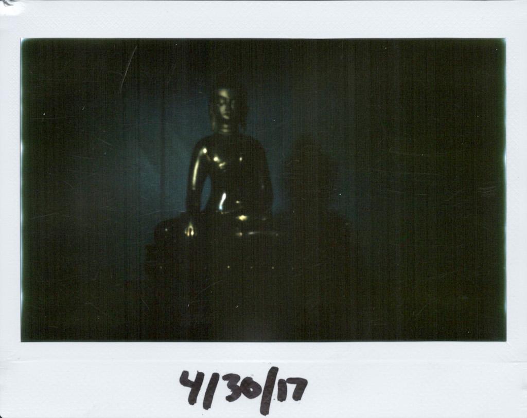 Side-lit Buddha.