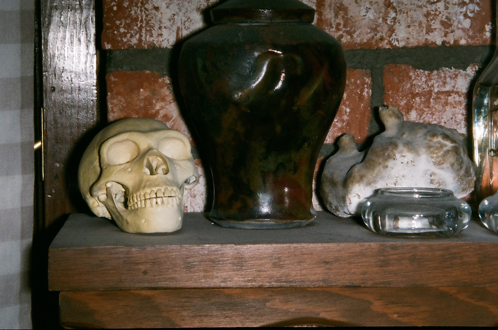 Still life with 1/4 scale Neanderthal skull, urn, and stalagmite.  Ignored the parallax marks & cut off the urn.