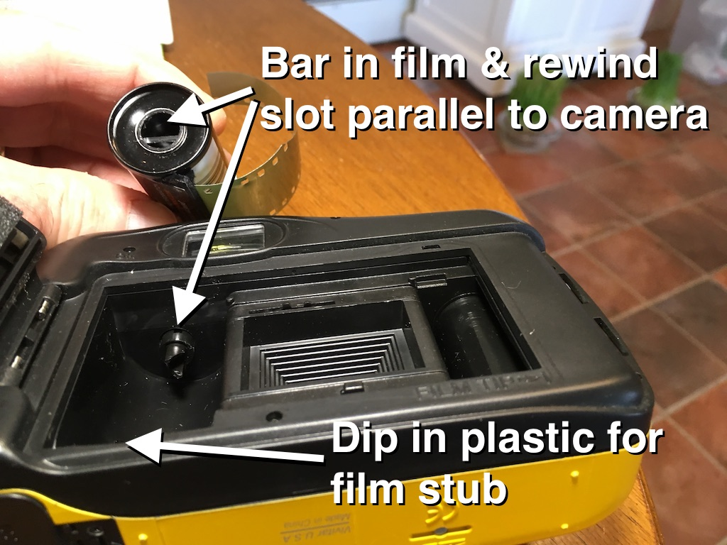 I've had better luck with the rewind slot in the camera and the bar in the film parallel to the camera.  You can see there's a small dip in the plastic at the bottom of the chamber.