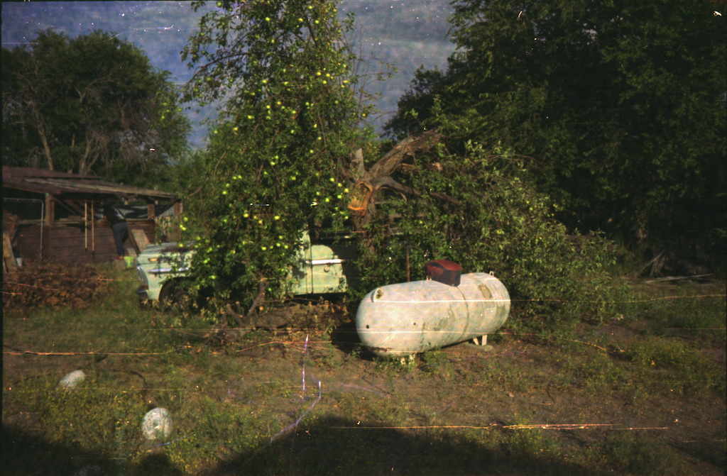 Propane tank, apple tree, & truck.