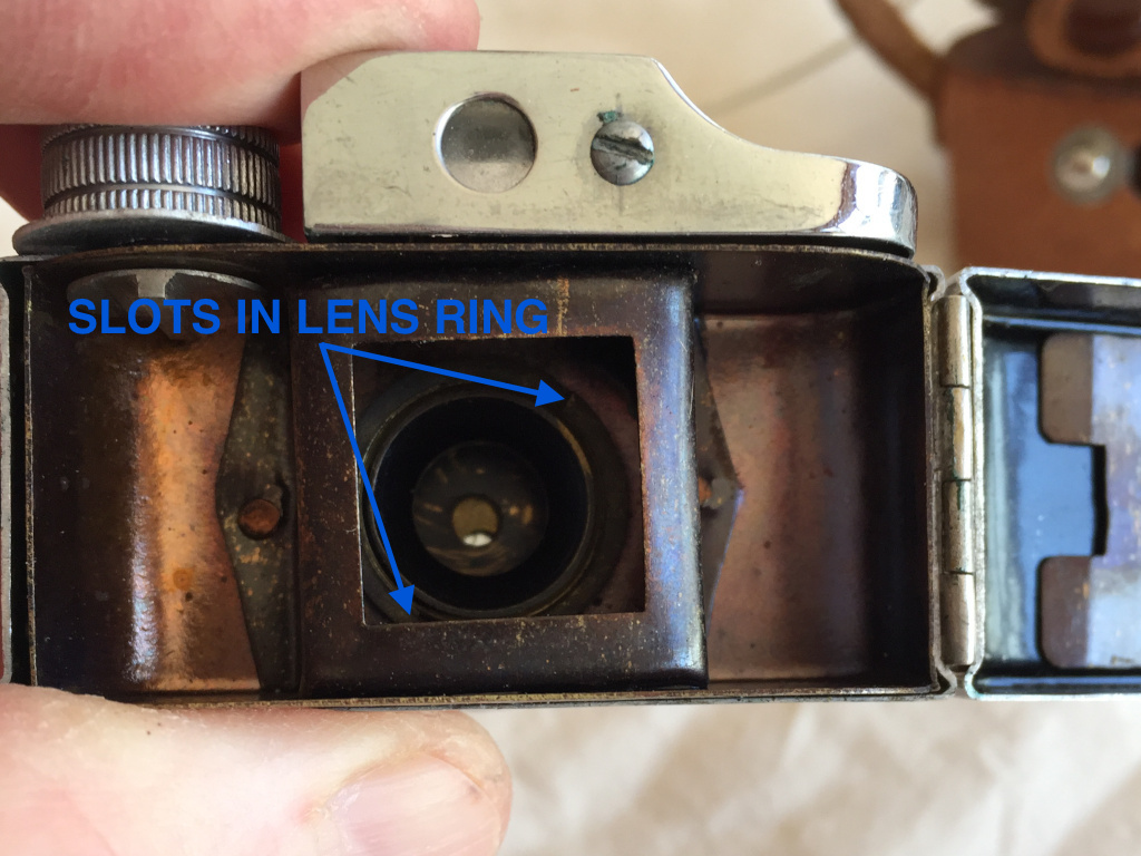 Remove the lens ring inside the body. It's a left hand thread. I couldn't get a lens wrench past the film gate so I used a couple of small screwdrivers.