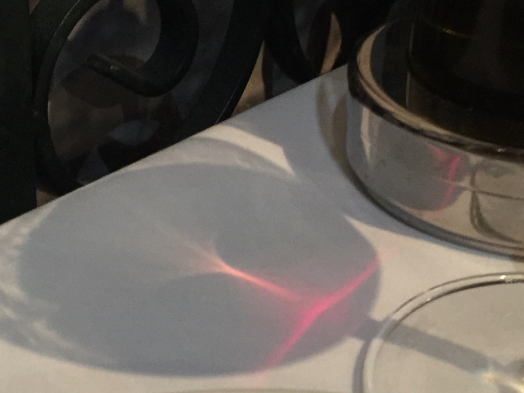 The light through the wine glass looks like a disgruntled alien.