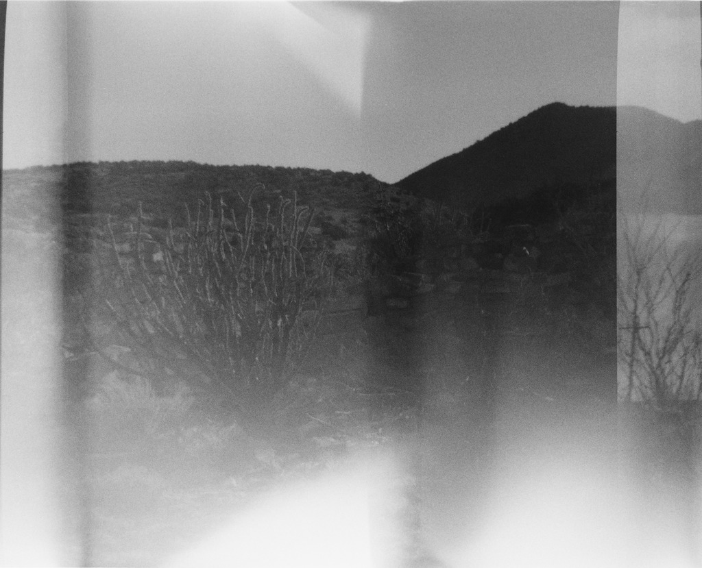 Light leak, flare, frame overlap, & I think the film moved in my pack - I didn't put a ratchet on the winder.